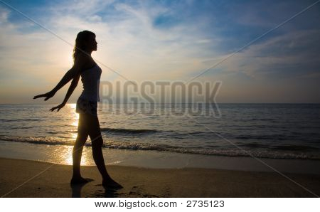 Silhouette Of A Woman Relax By The Beach