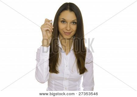 Young businesswoman writing with pen
