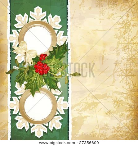vintage retro christmas background with sprig of European holly, torn paper and two frames