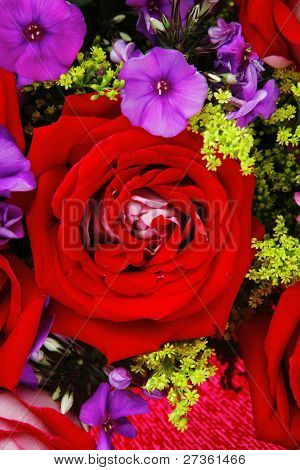flowers : big bouquet of rose and pansy flowers with green grass in red wrapping paper