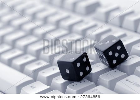 Dice rolled on a computer keyboard