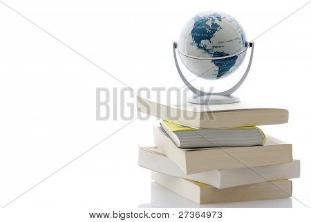 Globe on pile of books