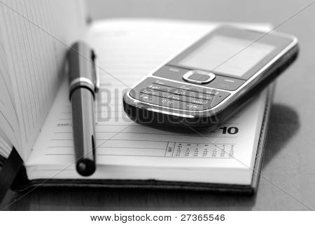 Cellphone and fountain pen on diary