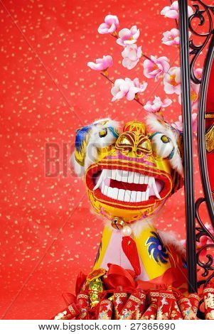 traditional chinese dancing-lion on a festive background,the lion is believed to be able to dispel evil and bring good luck and prosperity in China.