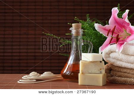 Spa still life with essential oil,soap and towel