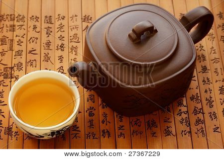 Traditional chinese tea on bamboo books