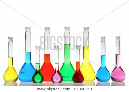 Laboratory glassware with liquids of different colors isolated on white background