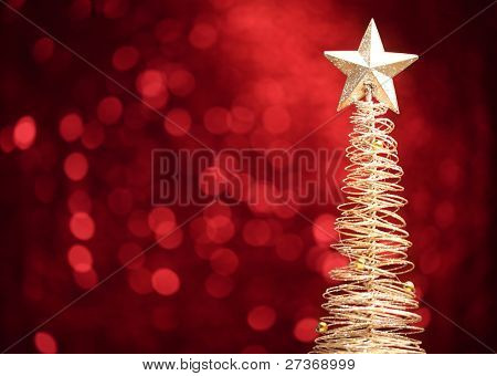Golden christmas tree on abstract light background.