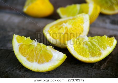 Lemon quarters over an old wooden table