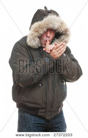 man in jacket warming oneself. isolated on white background