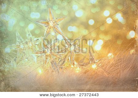 Vintage holiday lights with sparkle background
