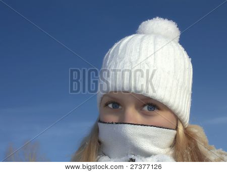 Girl with scarf covering her mouth and nose