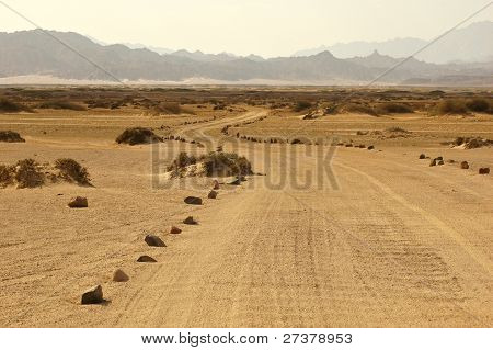 Curvy Unimproved Road Going Through The Desert
