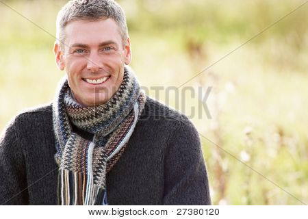 Close Up Of Man Outdoors Walking In Autumn Landscape