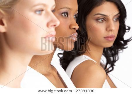Portrait Of Three Attractive Young Women In Studio Standing In Line