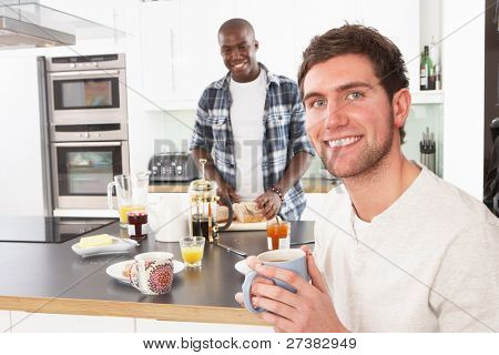Two Young Men Preparing Breakfast In Modern Kitchen