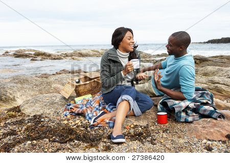 Couple having picnic on beach