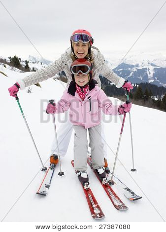 Young Mother And Daughter On Ski Vacation