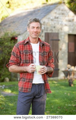 Man in country garden