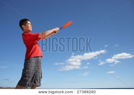 Teenage boy playing baseball