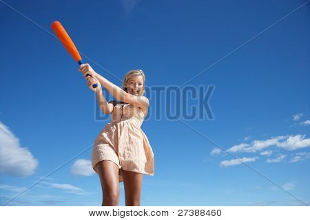 Teenage girl playing baseball