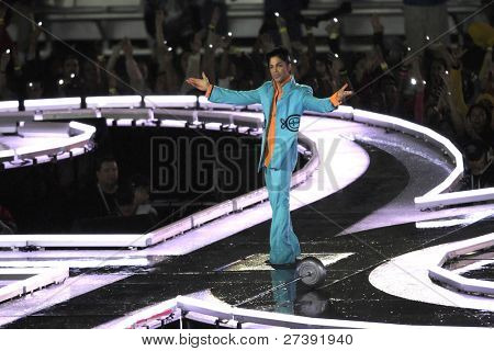 MIAMI - FEB 4: Prince gestures as he performs during half-time for Super Bowl XLI between the Chicago Bears and the Indianapolis Colts at Dolphin Stadium on February 4, 2007 in Miami.