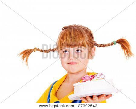 Funny kid holding birthday cake