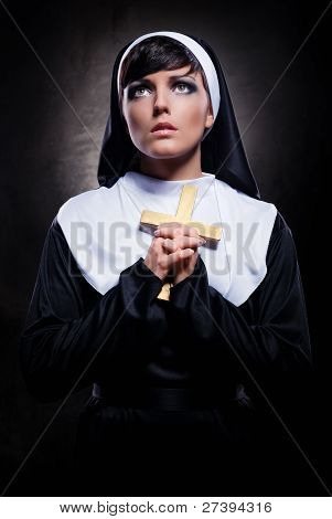 Young Attractive Nun Holding A Cross