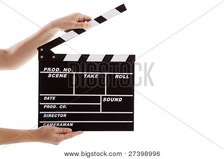 Female hands holding a clapboard, isolated on white