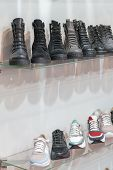Leather Shoes On The Shelf In The Store. Shoes And Sneakers In The Shoe Store. Vertical Photo poster