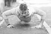 Strength And Motivation. Man In Sportswear Doing Push Ups Outdoor. Guy Motivated Workout In Park. Sp poster