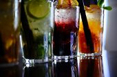 Enjoy A Drink. Iced Drinks In Cocktail Glasses In Bar. Alcoholic Mixed Drinks With Ice. Juicy Bevera poster