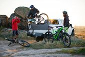 Friends Cyclists Getting Ready for Bike Riding and Taking the Bicycles off the Pickup Offroad Truck  poster