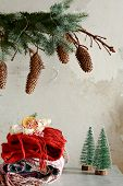 A Pile Of Warm Clothes On The Table. Christmas Atmosphere In The House. Room Decorated With Fir Bran poster