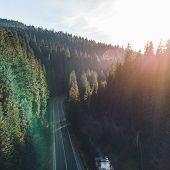 Aerial View Empty Road In Mountain Forest Road Trip On Sunshine Road Trip Concept poster