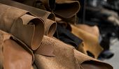 Different Pieces Of Leather In A Rolls. The Pieces Of The Colored Leathers. Rolls Of Natural Brown R poster