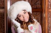 Fashion Studio Portrait Of Beautiful Lady In White Fur Coat And Fur Hat Mittens.winter Beauty In Lux poster