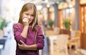 Young beautiful girl over isolated background looking stressed and nervous with hands on mouth bitin poster