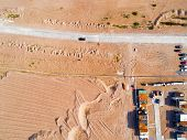 Aerial View Of Road With Car. Aerial View Of A Country Road With Moving Car And Sand. Car Passing By poster