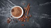 Top View Of Cocoa Powder In White Bowl And Whole Beans With Spices poster