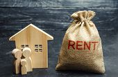 A Bag With Money And The Inscription Rent And The Family Is Standing Near The House. Removable Housi poster