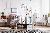 Black And White Patterned Carpet On Wooden Floor In Stylish Kids Bedroom Interior With Scandinavian poster