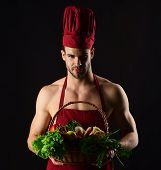 Organic Food. Cooking Vegetarian. Male Cook. Chef With Basket Of Vegetables. Cook In Uniform Holds W poster