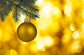 Decoration In The Form Of A Golden Ball With A Glare On The Side Of A Green Christmas Tree And A Blu poster