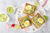 Toasts With Avocado Guacamole, Fresh Radish, Boiled Egg, Chia And Pumpkin Seeds. Diet Breakfast. Del poster