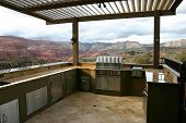stock photo of louvers  - Custom outdoor kitchen with overhead louvers and a magnificent view of a southern Utah canyon - JPG