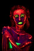 Portrait Of A Beautiful Young Sexy Girl With Ultraviolet Paint On Her Body. Pretty Woman With Glowin poster