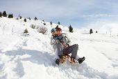 picture of toboggan  - Young Couple Sledding - JPG