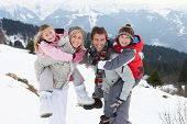 stock photo of pre-teen boy  - Young Family On Winter Vacation - JPG