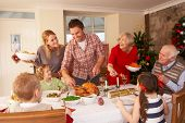 stock photo of carving  - Family serving Christmas dinner - JPG